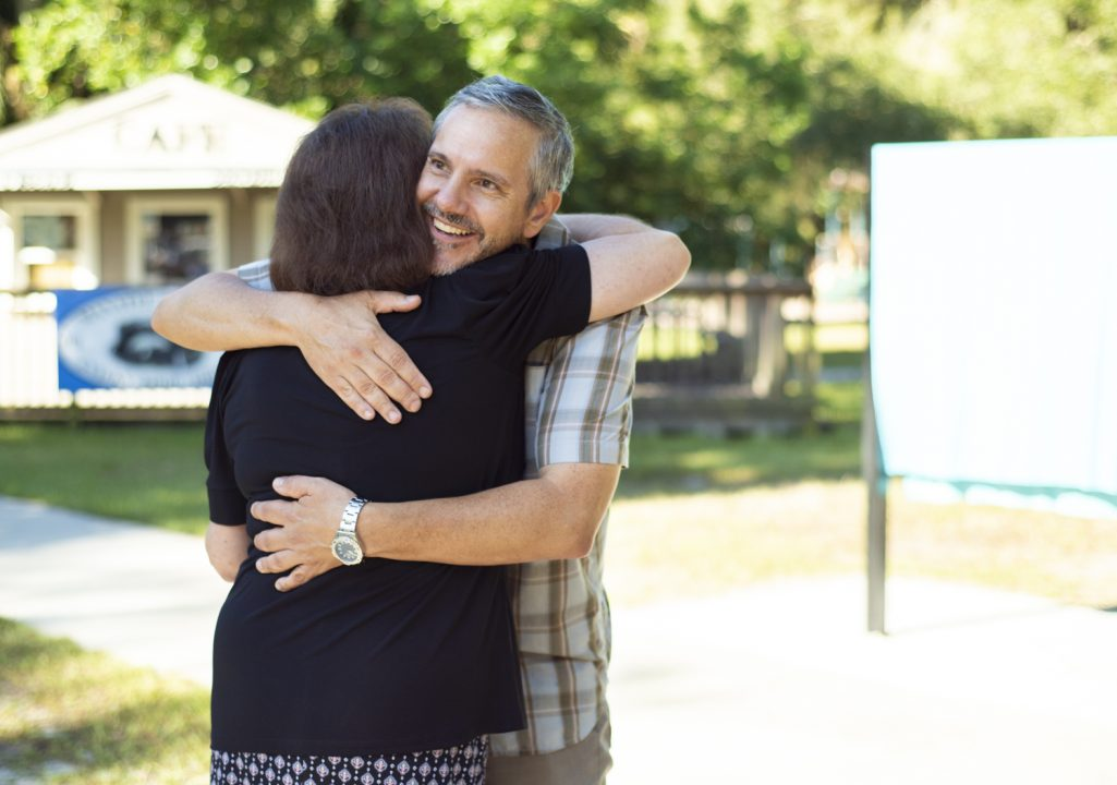 Cindy shares a hug with Dr. Tony Abbott – they are both excited at this long-brewing project now finalized and in the ground.