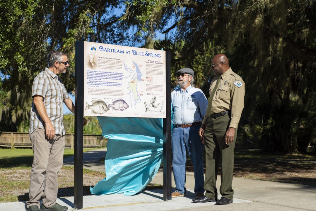 Dr. Tony Abbott of Stetson University, Bill Crippen of River of Lakes Heritage Corridor/ Orange City Government, and Darrell Thomas, the Blue Spring Ranger who oversaw installation, unveil the new kiosk at Blue Spring State Park.