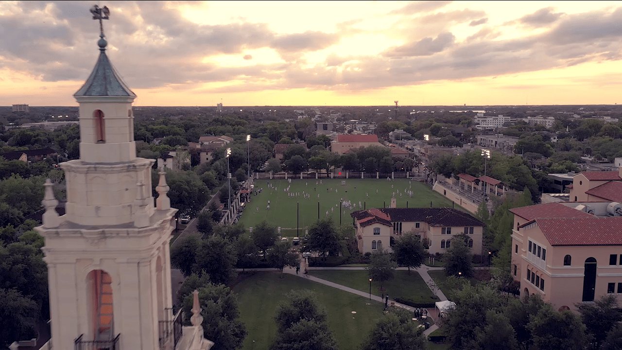 Aerial Photo of Chapel Tower on Rollins College Campus with Lacrosse Players on Field at Sunset